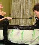Slave gags on feet